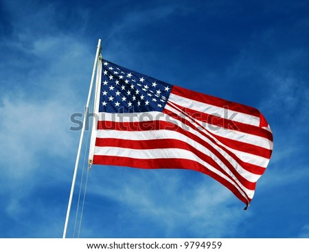 American flag waving in a blue sky.