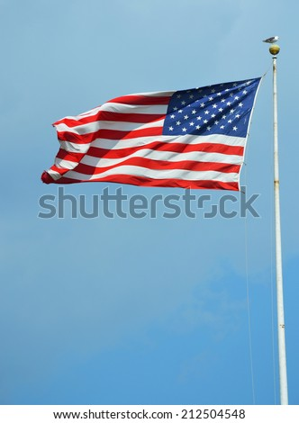 American flag waving in a sky - stock photo