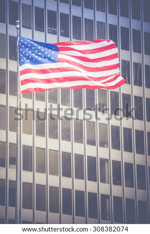 American flag waving in the breeze in the Chicago downtown loop business district. - stock photo
