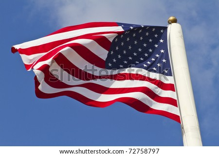 american flag waving in the wind, focus set on the Stars.