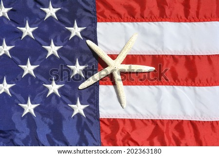 American flag with a white starfish on it - stock photo