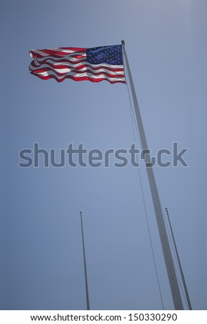 American Flag with Blue Sky - stock photo
