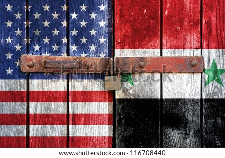 American flag with the flag of Syria on the background of old locked doors - stock photo