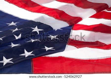 American flag with white stars on a blue field and red and white stripes
