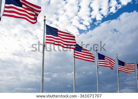 American flags winding on the blue sky