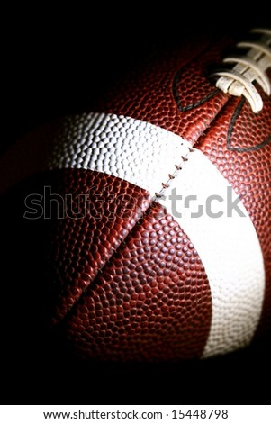 american football against a black background