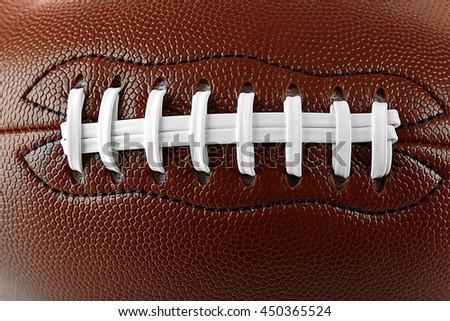 American football ball, macro view - stock photo