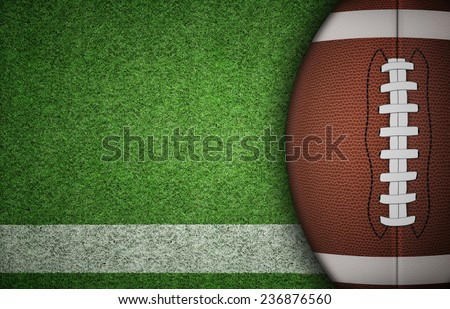American football ball on green grass and white line. with lots of copy space. - stock photo
