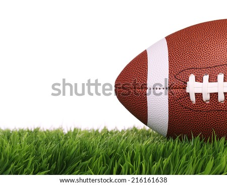 American Football. Ball on Green Grass, isolated on white - stock photo