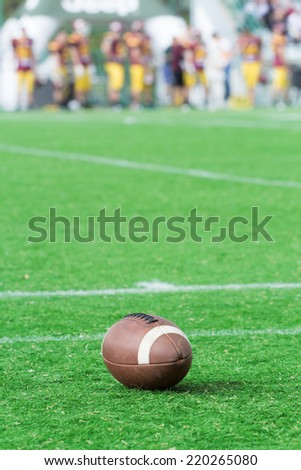 American football ball on the court.
