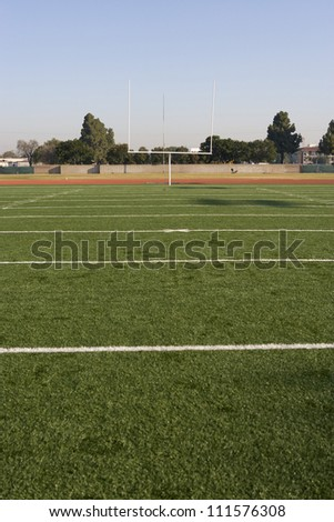 American football field with goal post in background - stock photo