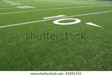 American Football Field Yard Lines at the Fifty - stock photo