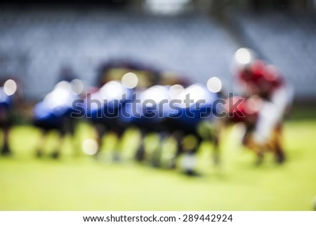 American football game - out of focus background - stock photo