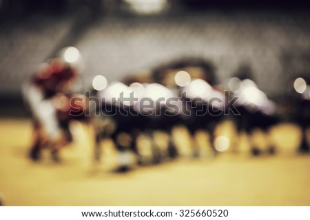 American football game - out of focus background of the field - retro styled photo - stock photo