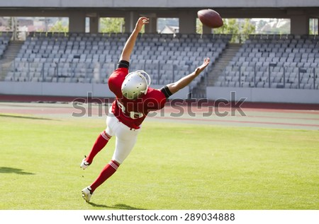 American football game. Players in action - stock photo