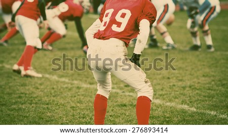 american football game - retro style photograph - stock photo
