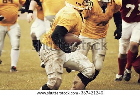 American football game - retro styled photo - stock photo