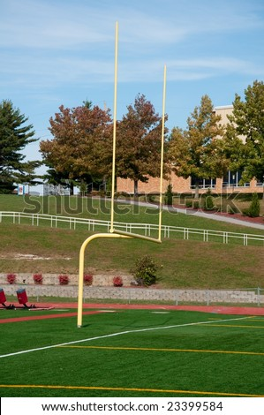 American Football goal post in high school field - stock photo