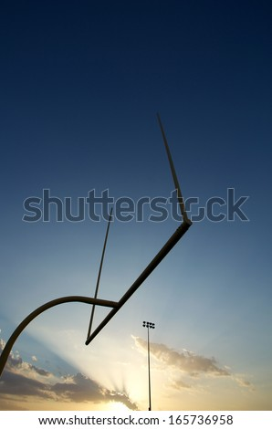 American Football Goal Posts or Uprights at Sunset - stock photo