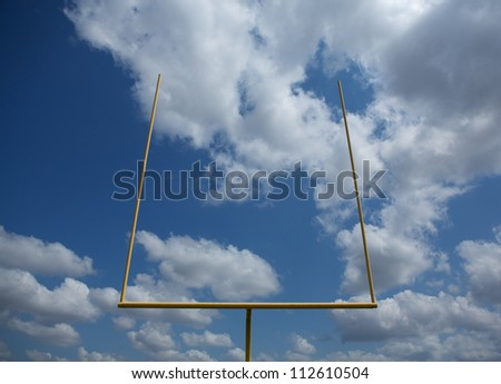 American Football Goal Posts or Uprights on a Cloudy Day - stock photo