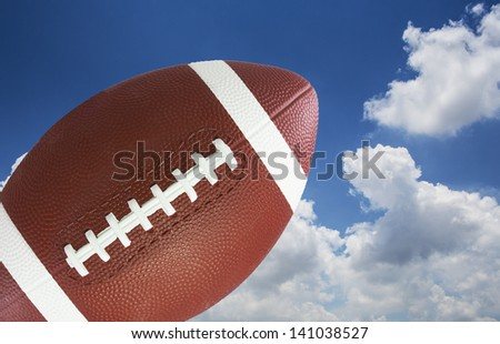 American football in blue sky