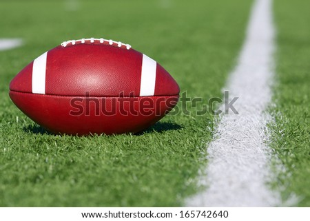 American Football near the Yard Line - stock photo