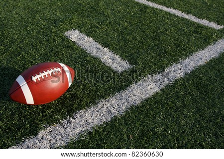 American Football near the yard lines or hashmarks - stock photo
