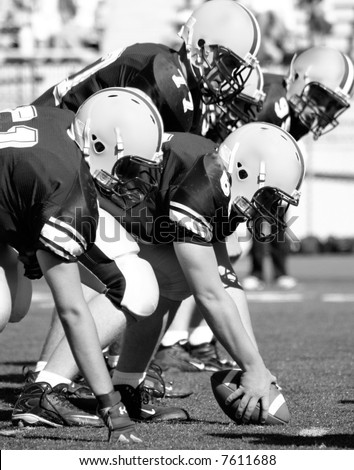 American Football, Offensive Linemen, Concept: Move Forward, Hike the Ball Black and white photo - stock photo