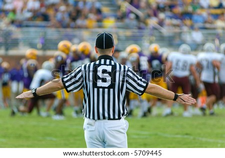 American Football Official  or referee working a game - stock photo