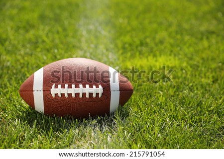 American Football on Field with yard line - stock photo
