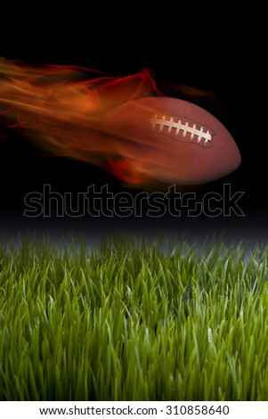 American football on fire and smokin hot. - stock photo