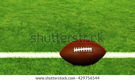 American football on football field background