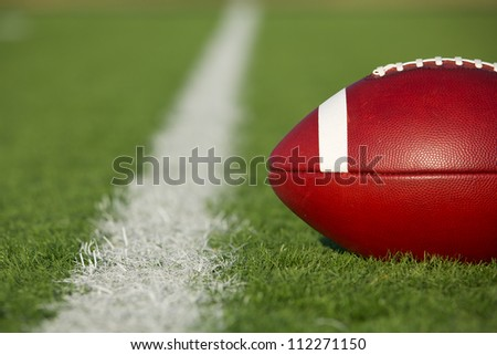 American Football on the Field near the yard line with room for copy - stock photo