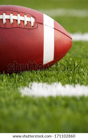 American Football on the Field near the Yard Lines - stock photo