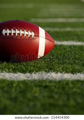 American Football on the Field near yard lines with room for copy - stock photo