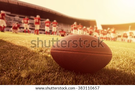 American football on the field, players in the background