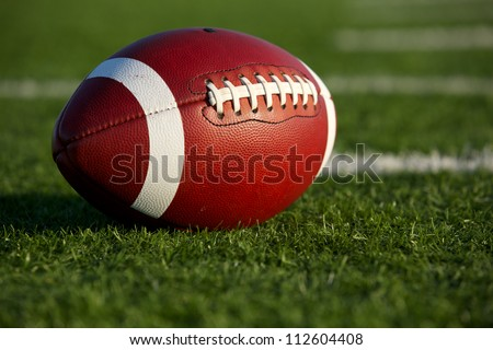American Football on the Field with Yard Lines Beyond