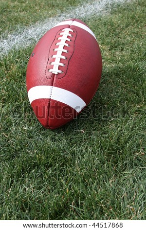 American Football on the Grass with Room for Copy