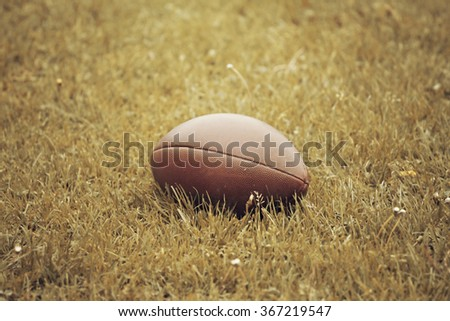 American Football on the ground - retro styled photo