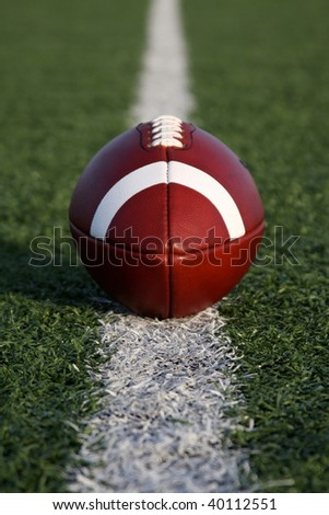 American Football on the line - stock photo