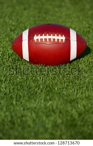 American Football on the Turf with copyspace below - stock photo