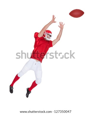 American Football player catching ball. Isolated on white