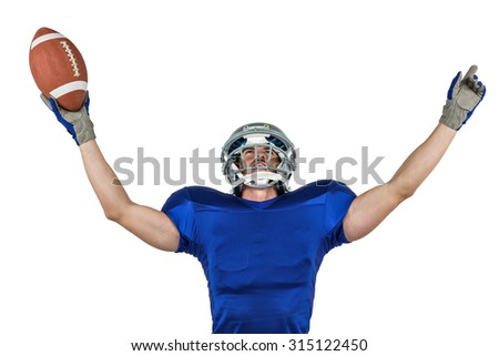 American football player gesturing victory against white background - stock photo