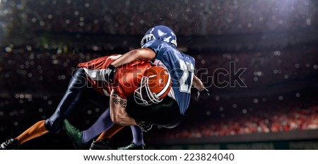 American football player in action at game time - stock photo