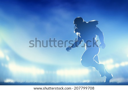 American football player in game, running. Night stadium lights - stock photo
