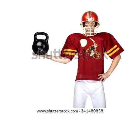 American football player in red uniform posing with dumbbell on white isolated background