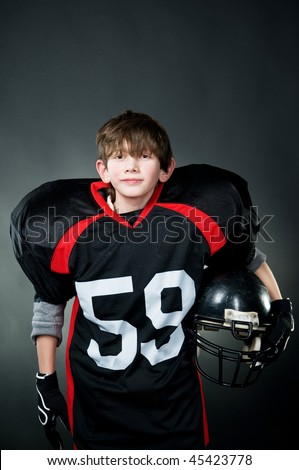 American football player isolated on black - stock photo