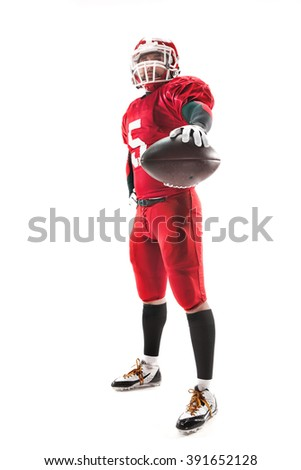 American football player posing with ball on white background - stock photo