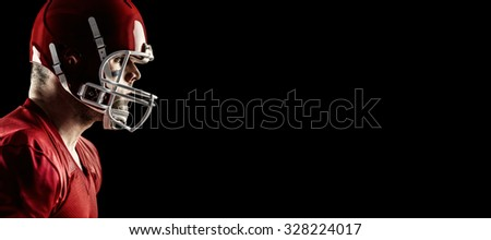 American football player side profile against black