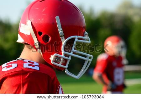 american football player wearing red helmet - stock photo